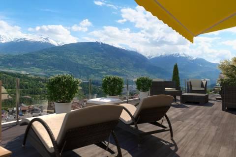 Terrasse ensoleillée avec vue panoramique sur les montagnes